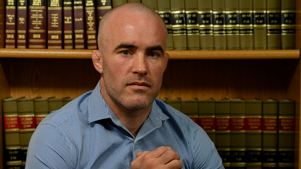 Wrestler Andy Hrovat sits in his attorney's office in Denver on Feb. 20, 2020, for an interview about his experience with a former University of Michigan doctor accused by several former students of sexual abuse.