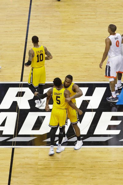 UMBC players celebrate their 74-54 win over Virginia in a first-round game in the NCAA men's college basketball tournament in Charlotte, N.C.