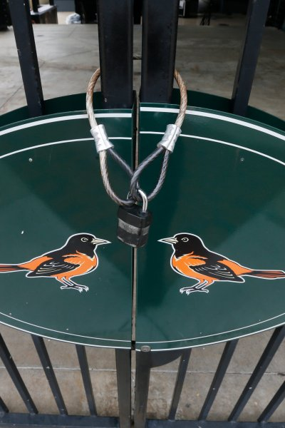 Locked gates and empty walkways are shown at Oriole Park at Camden Yards, home of the Baltimore Orioles baseball team, on what was to be opening day March 26, 2020, in Baltimore, Md.