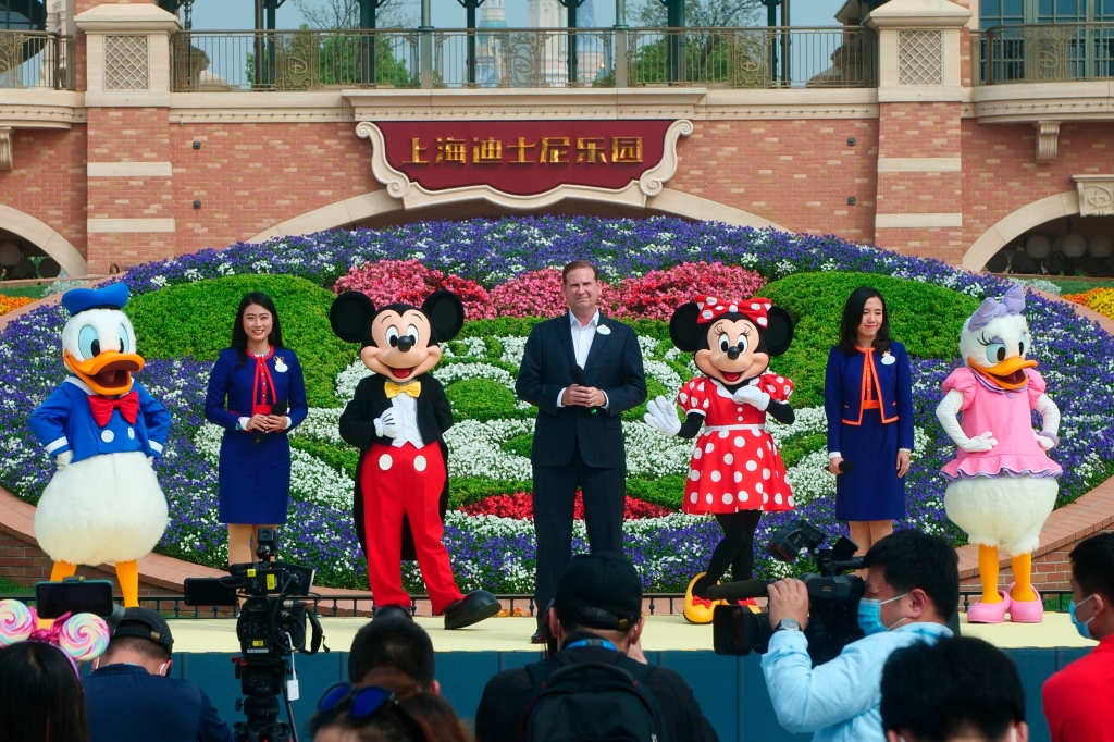 Mickey and Minnie Mouse take the stage in a reopening ceremony for Disneyland in Shanghai as the theme park reopened, Monday, May 11, 2020.