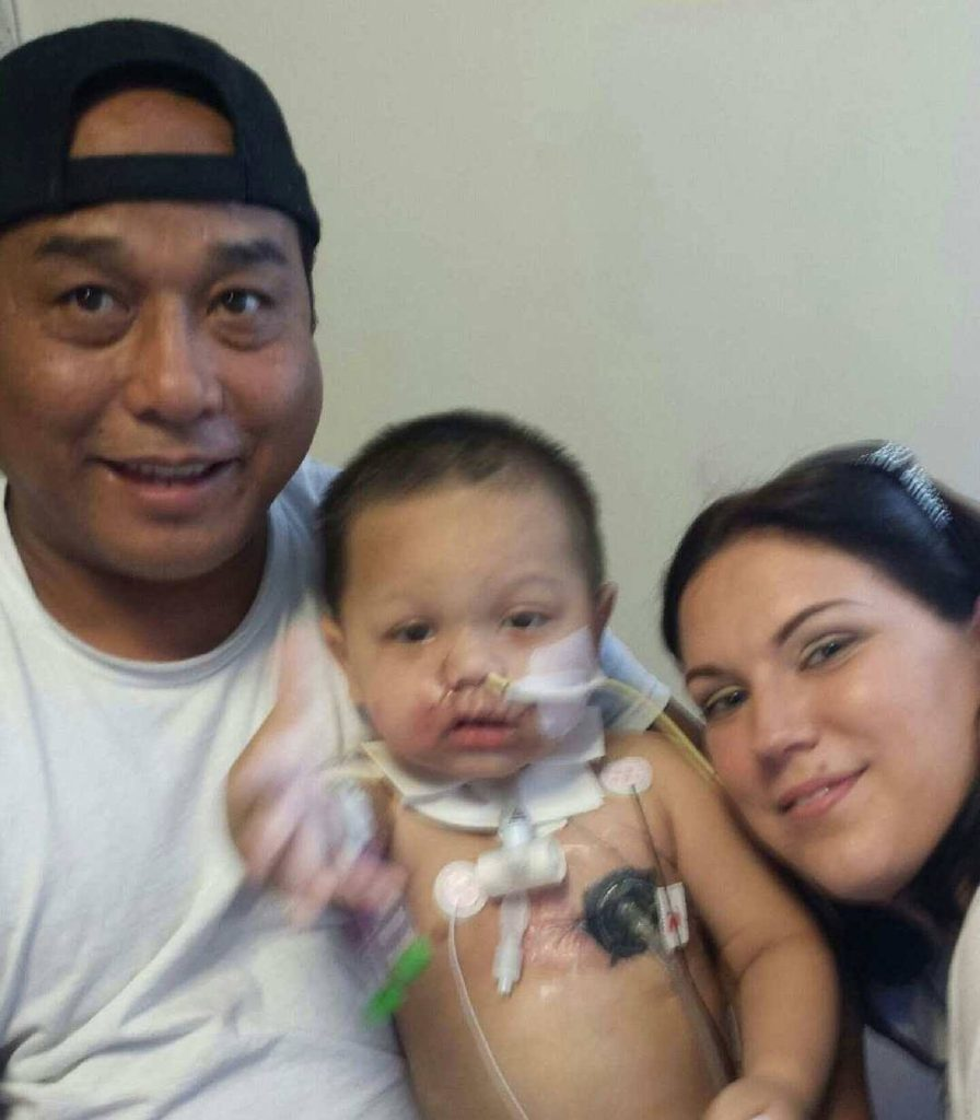 Bounkham Phonesavanh and his parents in the hospital