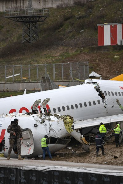 Turkish soldiers stand guard after a Pegasus Airlines Boeing 737 airplane skidded off the runway upon landing at the Sabiha Gokcen airport, in Istanbul, on February 6, 2020, killing three people and injuring 179.