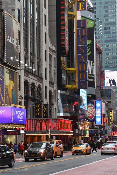 A view of signage down 42nd Street in NY
