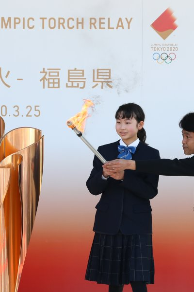 The Olympic flame is lit at the cauldron