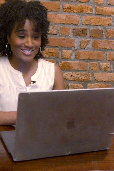 Ngozi sitting at a laptop