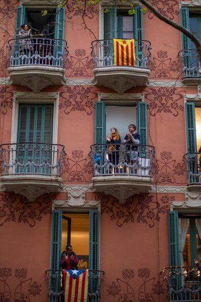People applaud from their houses in support of the medical staff that are working on the COVID-19 virus outbreak in Barcelona, Spain, Sunday, March 29, 2020.