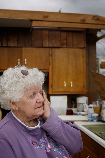 Emma Pritchett wipes a tear away in her roofless kitchen the day after a tornado hit, April 13, 2020, in Chatsworth, Ga. Severe weather has swept across the South, killing multiple people and damaging hundreds of homes from Louisiana into the Appalachian Mountains.