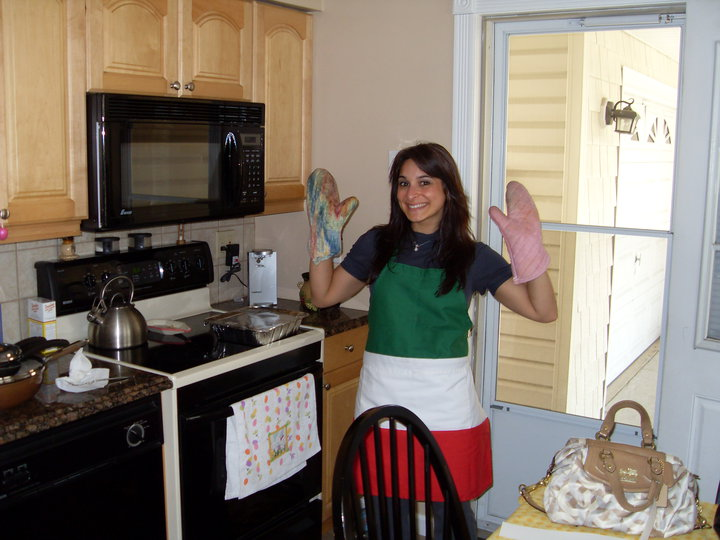 Leah Lupo cooks in an apron with the colors of Italy's flag.