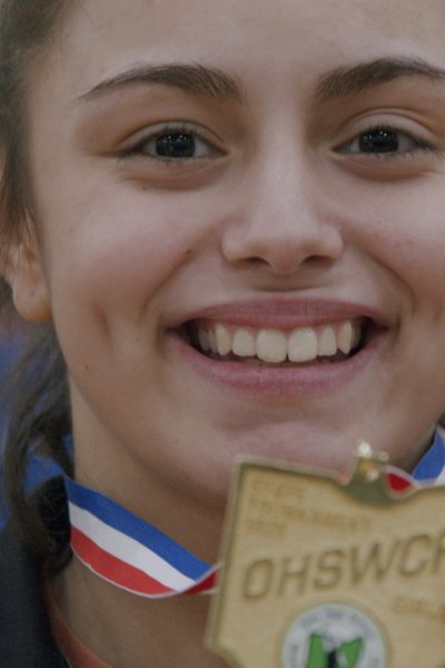 Leilah Castro holding a medal