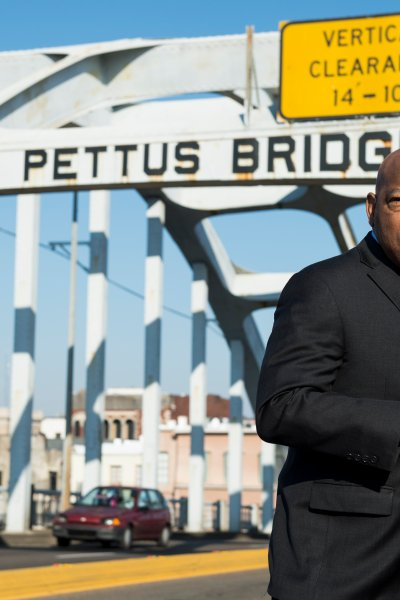 """Rep. John Lewis, D-Ga., stands on the Edmund Pettus Bridge in Selma, Ala., in between television interviews on Feb. 14, 2015. Rep. Lewis was beaten by police on the bridge on """"Bloody Sunday"""" 50 years ago on March 7, 1965, during an attempted march for voting rights from Selma to Montgomery."""