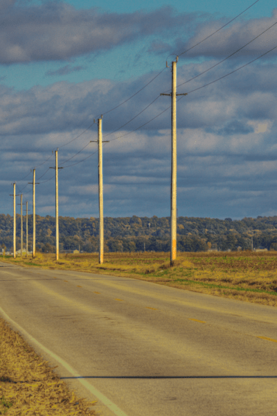 Empty country road with telephone poles in Delta, Missouri.