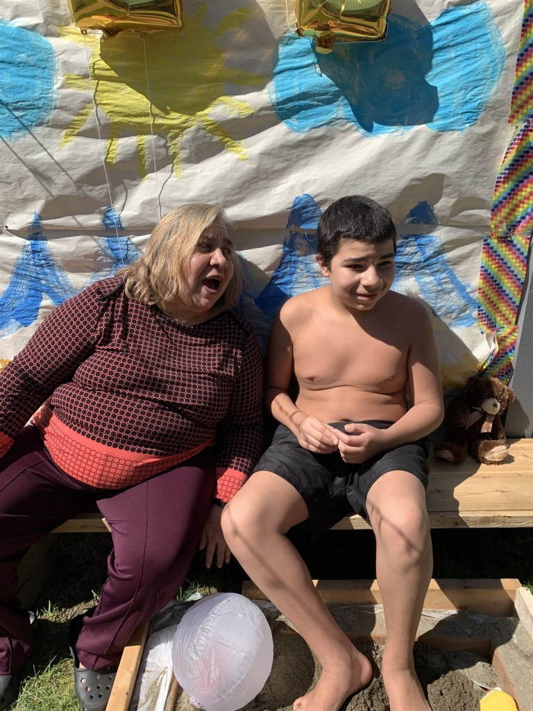 """Zach with his grandmother. When school ended abruptly, his mother says, Zach began to self-harm. """"He would hit his head or he would bang his body up against the wall. It gets really difficult to see that. Behavior is communication. He is trying to tell me something."""""""