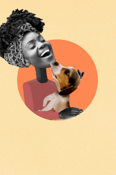 A women being licked by a dog