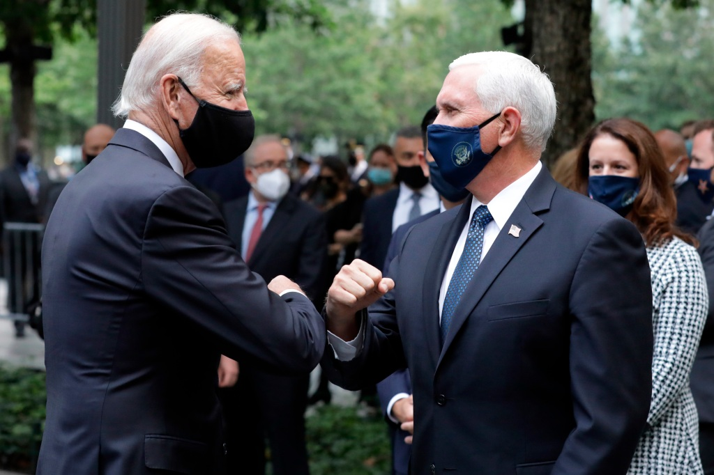 Democratic presidential candidate and former Vice President Joe Biden greets Vice President Mike Pence at the 19th anniversary ceremony in observance of the Sept. 11 terrorist attacks at the National September 11 Memorial & Museum in New York, Friday, Sept. 11, 2020.
