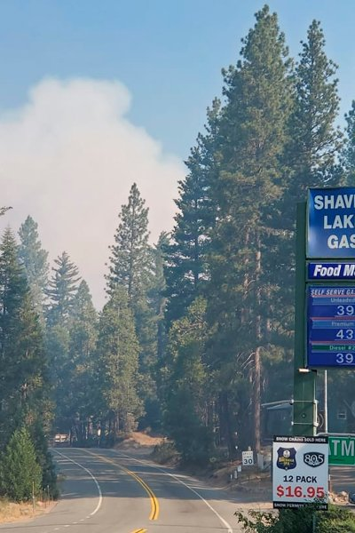 This photo released by the Fresno County Sheriff's Office shows smoke above Tollhouse Road in Shaver Lake, Calif., on Saturday, Sept. 5, 2020. A wildfire that broke out near Shaver Lake in the Sierra National Forest has prompted evacuation orders as authorities urged people seeking relief from the Labor Day weekend heat wave to stay away from the popular lake.