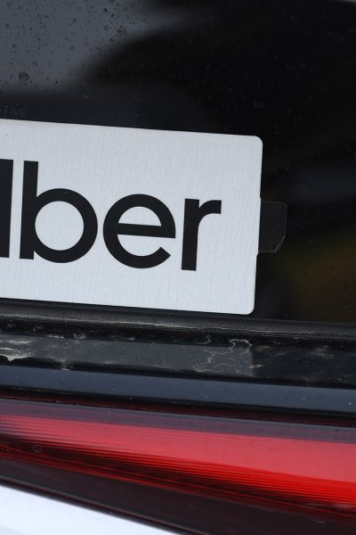 An Uber sticker is seen on a car at the start of a protest by ride share drivers.