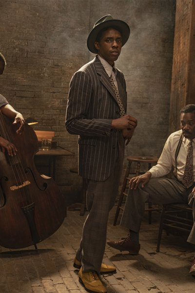 """This image released by Netflix shows Michael Potts, from left, Chadwick Boseman and Colman Domingo in """"Ma Rainey's Black Bottom."""" Netflix on Monday previewed George C. Wolfe's August Wilson adaptation """"Ma Rainey's Black Bottom,"""" showcasing Chadwick Boseman's final performance opposite Viola Davis' powerhouse blues singer."""