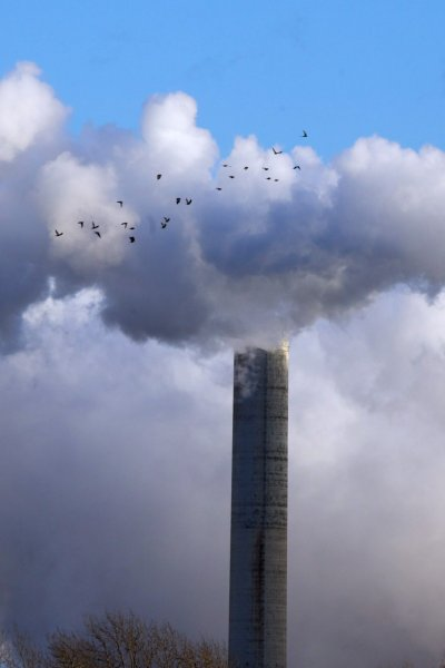 smokestacks and cooling towers greenhouse gas