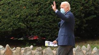 Democratic presidential nominee Joe Biden waves as he leaves St. Ann's Parish following a service, Oct. 11, 2020, in Wilmington, Delaware.