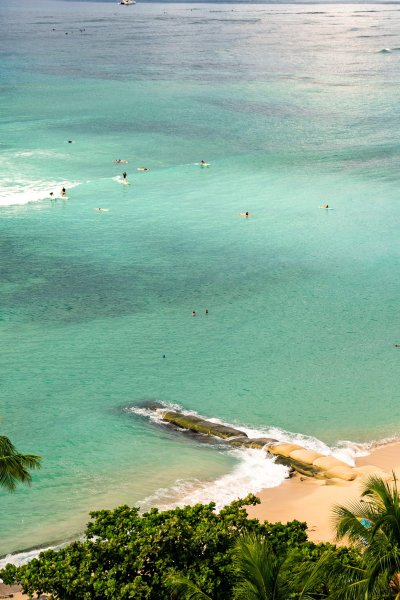 The normally packed stretch of Wakiki Beach has seen much less travelers since the onset of the Coronavirus pandemic