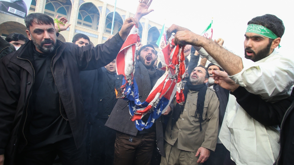"Iranians burn a U.S. flag during a demonstration against American ""crimes"" in Tehran on Jan. 3, 2020, following the killing of Iranian Revolutionary Guards Major General Qassem Soleimani in a strike on his convoy at Baghdad International Airport."