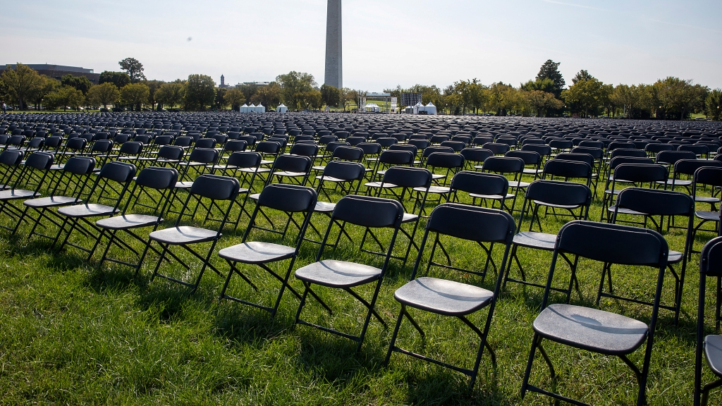 Empty chairs are on display to represent the 200,000 lives lost due to Covid-19 at the National Covid-19 Remembrance on the ellipse, behind the White House, Oct. 4, 2020, in Washington, D.C.