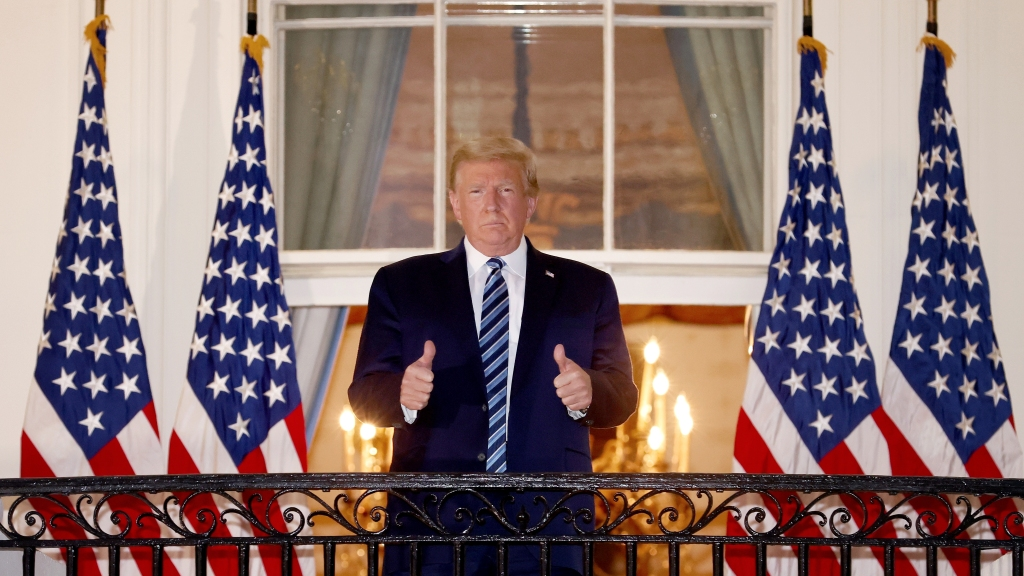President Donald Trump gives a thumbs up upon returning to the White House from Walter Reed National Military Medical Center on Oct. 5, 2020, in Washington, D.C. Trump spent three days hospitalized for coronavirus.