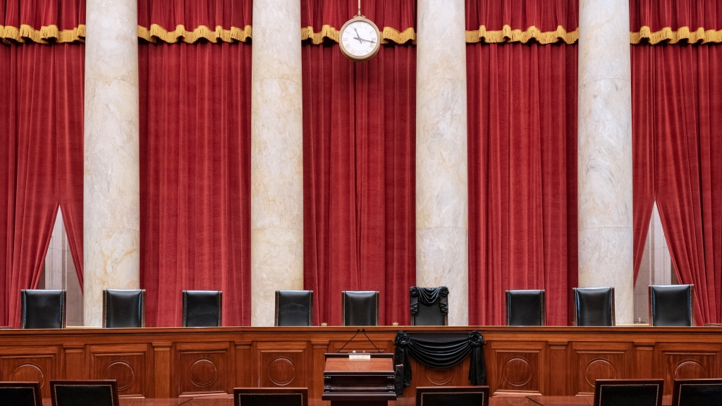 The bench and seat of Associate Justice Ruth Bader Ginsburg is draped in black cloth after her death, on Sept. 19, 2020 in Washington, D.C. Ginsburg was appointed to the Court by President Bill Clinton in 1993.