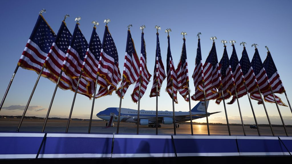 Air Force One is prepared for Donald Trump for his last ride as the President of the United States, as flags fly on a stage at Andrews Air Force Base, Maryland, Jan. 20, 2021.