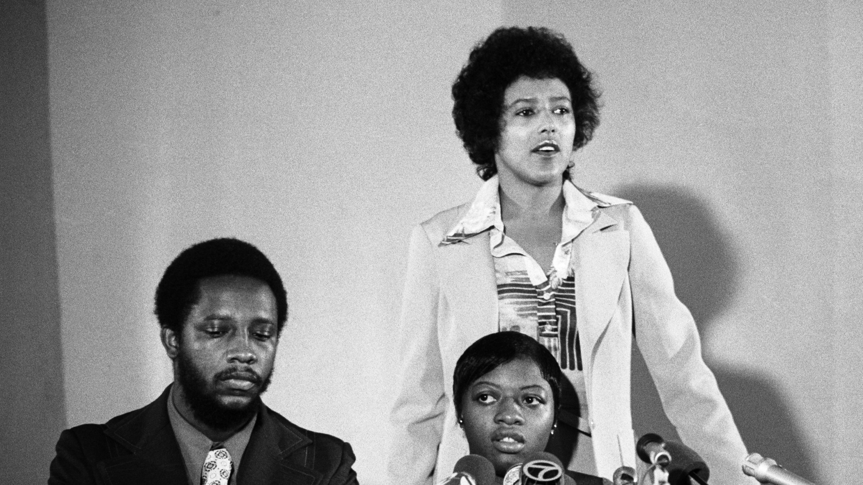 Elaine Brown, President of the Black Panther Party (back) presents Joanne Little, right, in Oakland, Calif., August 22, 1975. Little had recently been acquitted of the murder of her white jailer.