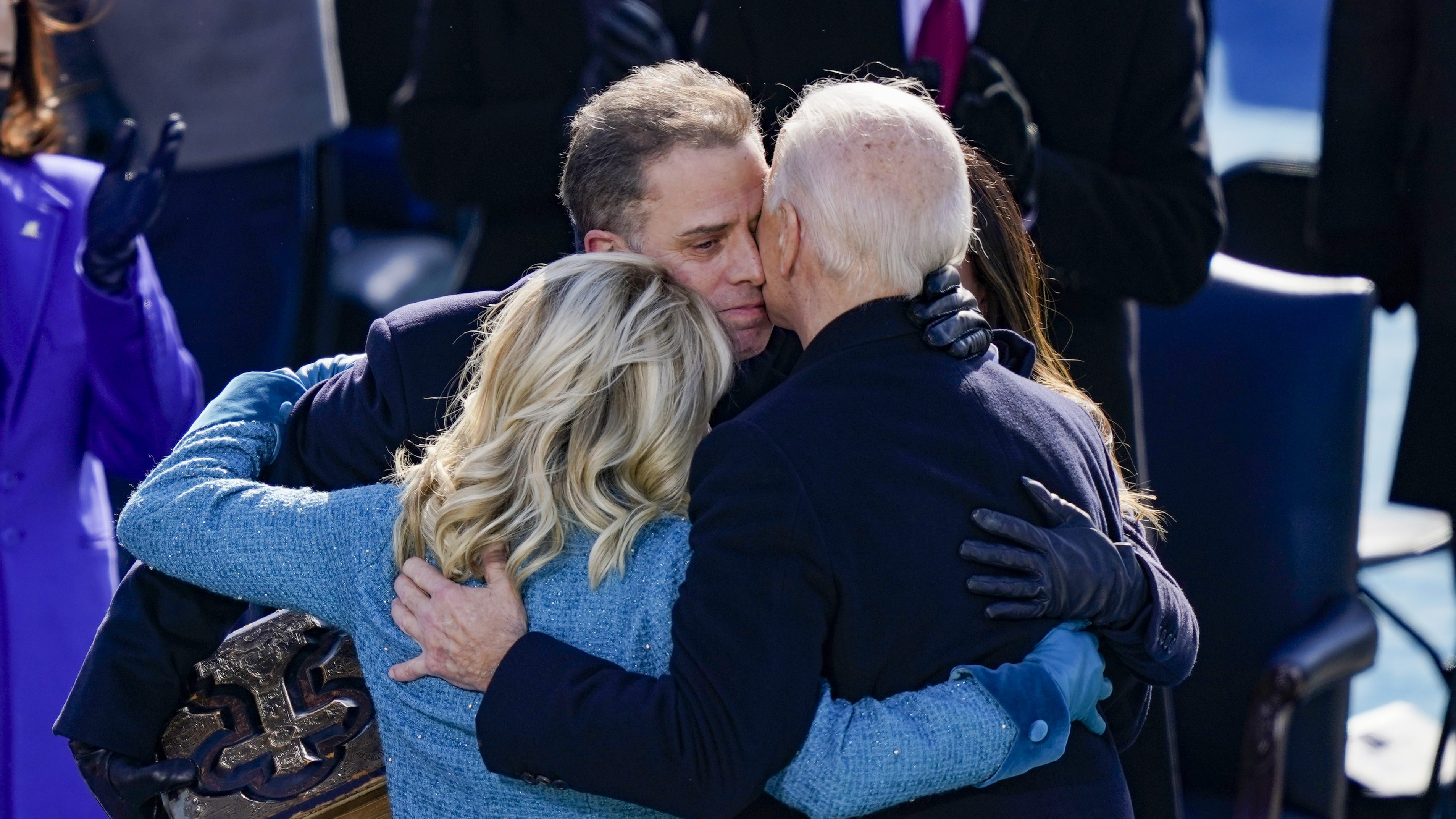 President Joe Biden embraces Dr. Jill Biden, son Hunter and daughter Ashley after being sworn in during his inauguration on the West Front of the Capitol, Jan. 20, 2021, in Washington, D.C. (Photo by Drew Angerer/Getty Images)