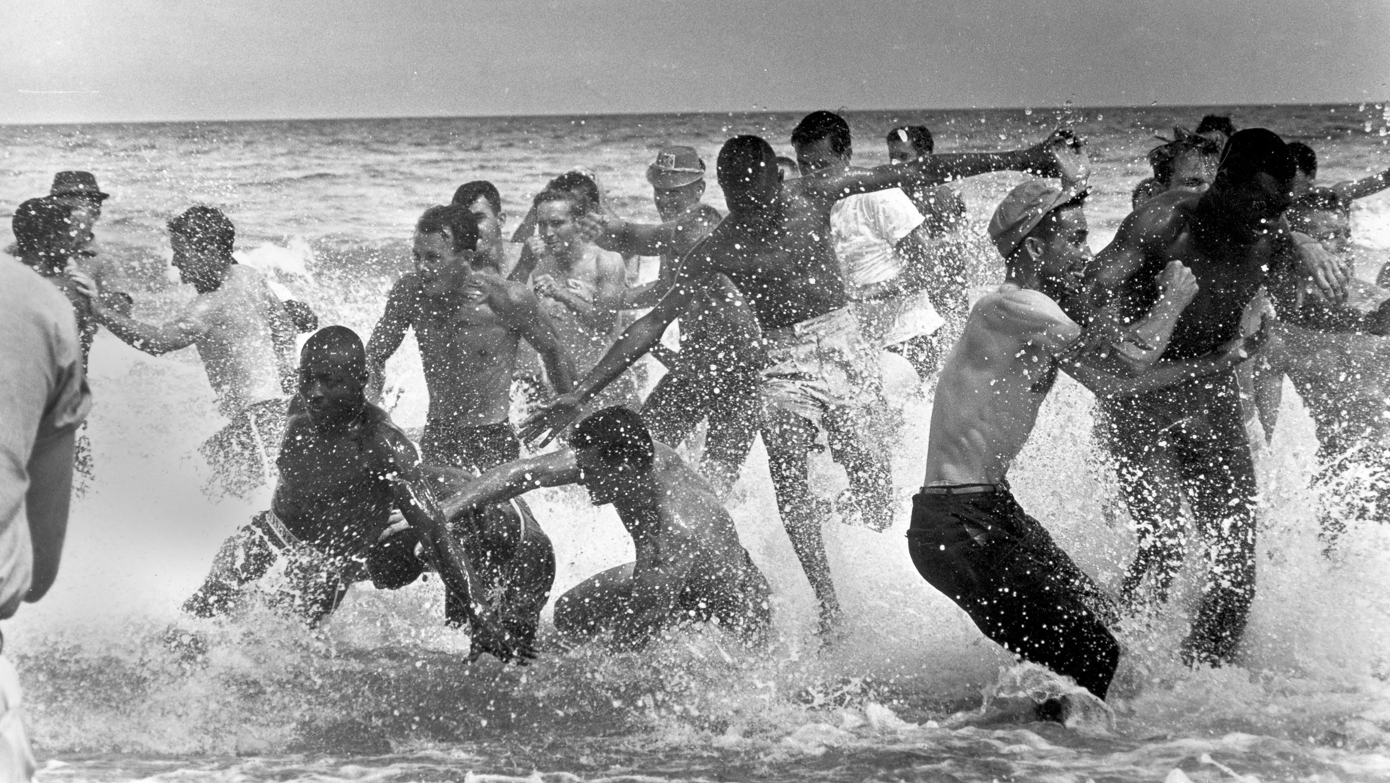 A group of white segregationists attack a group of Black activists as they began to swim at St. Augustine Beach, Florida, June 25, 1964.  Police moved in and broke up the fighting between the segregationist and civil rights demonstrators.