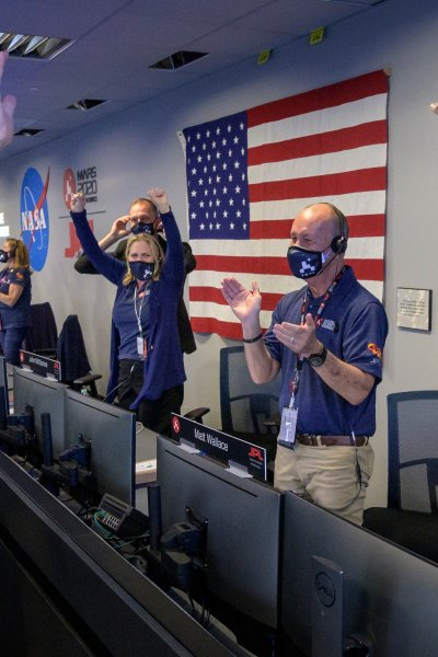 Members of NASA's Perseverance rover team react in mission control after receiving confirmation the spacecraft successfully touched down on Mars, , February 18, 2021 at NASA's Jet Propulsion Laboratory in Pasadena, California.
