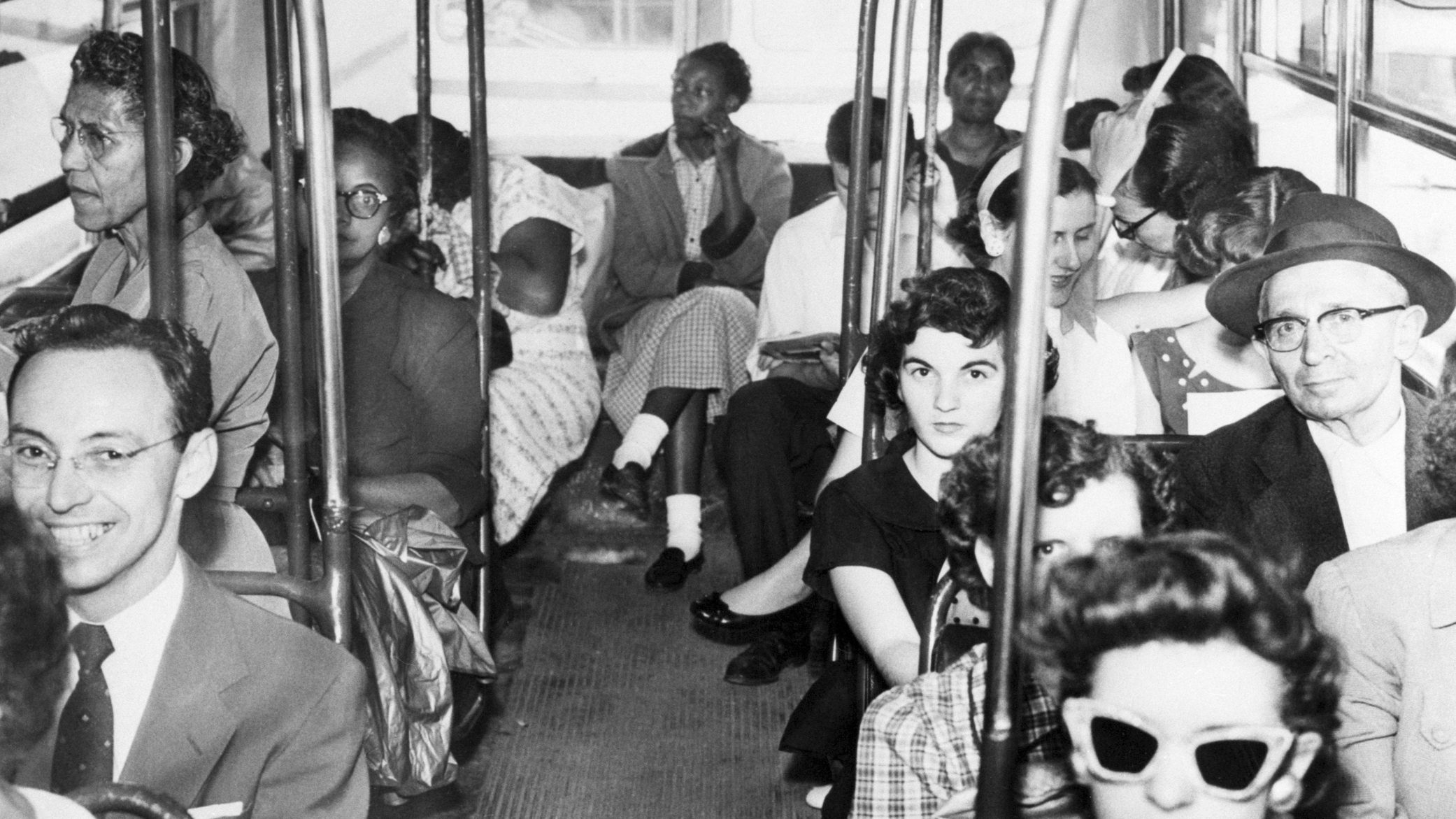 Riders continue to sit in segregated sections, due in part to pressure from white patrons, in this 1956 photo in Texas even as courts ruled to desegregate buses.