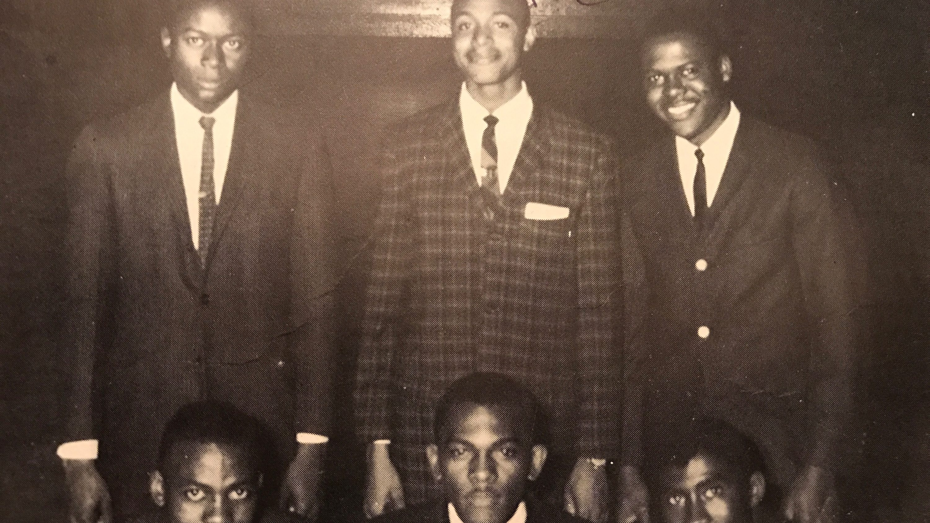 A 20-year-old Moore, top center, poses with fellow members of the Fayetteville sit-in planning committee.