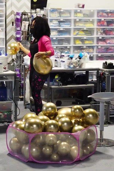 A balloon artist works in her studio