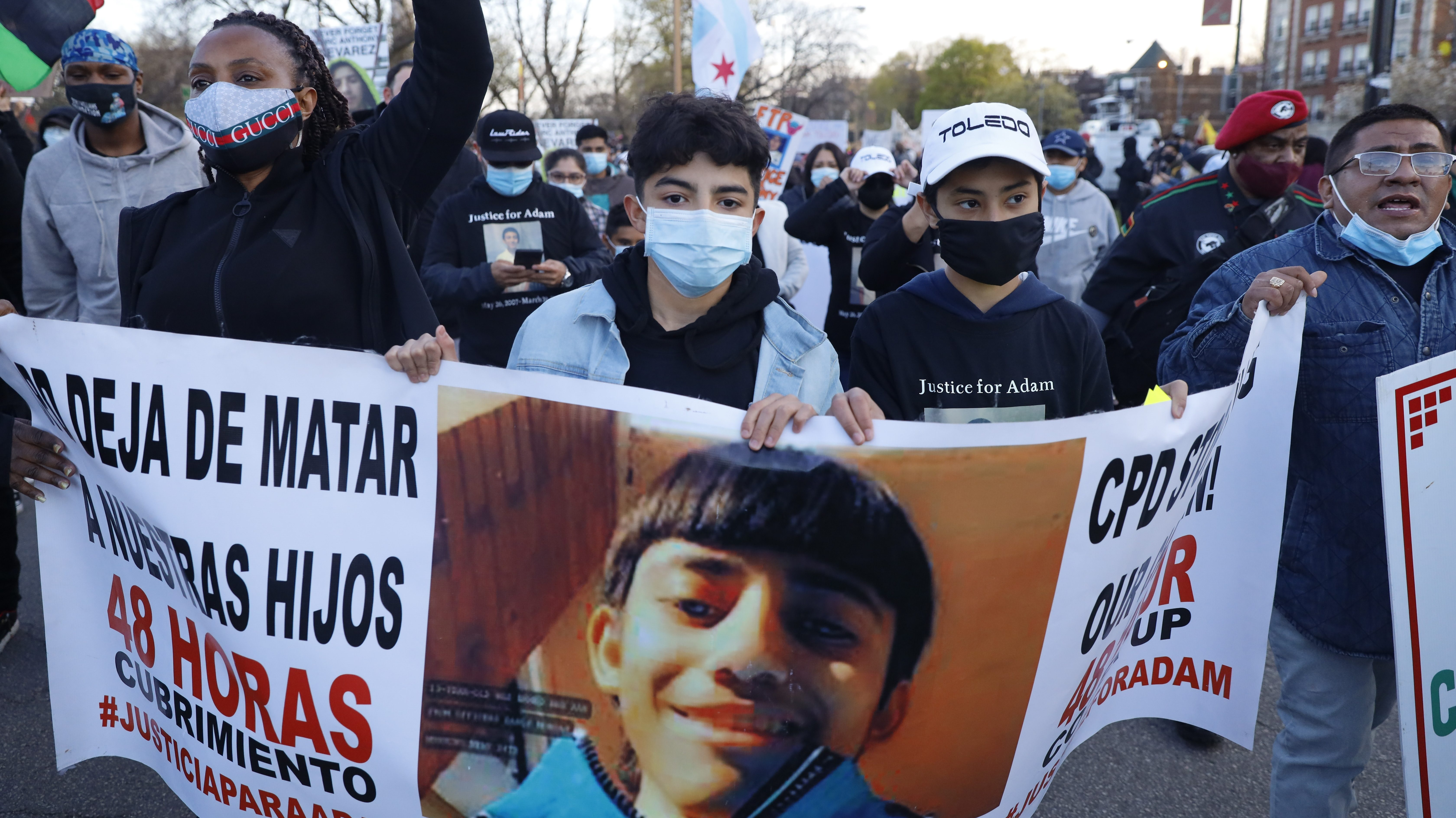 Demonstrators protest the shooting of 13-year-old Adam Toledo