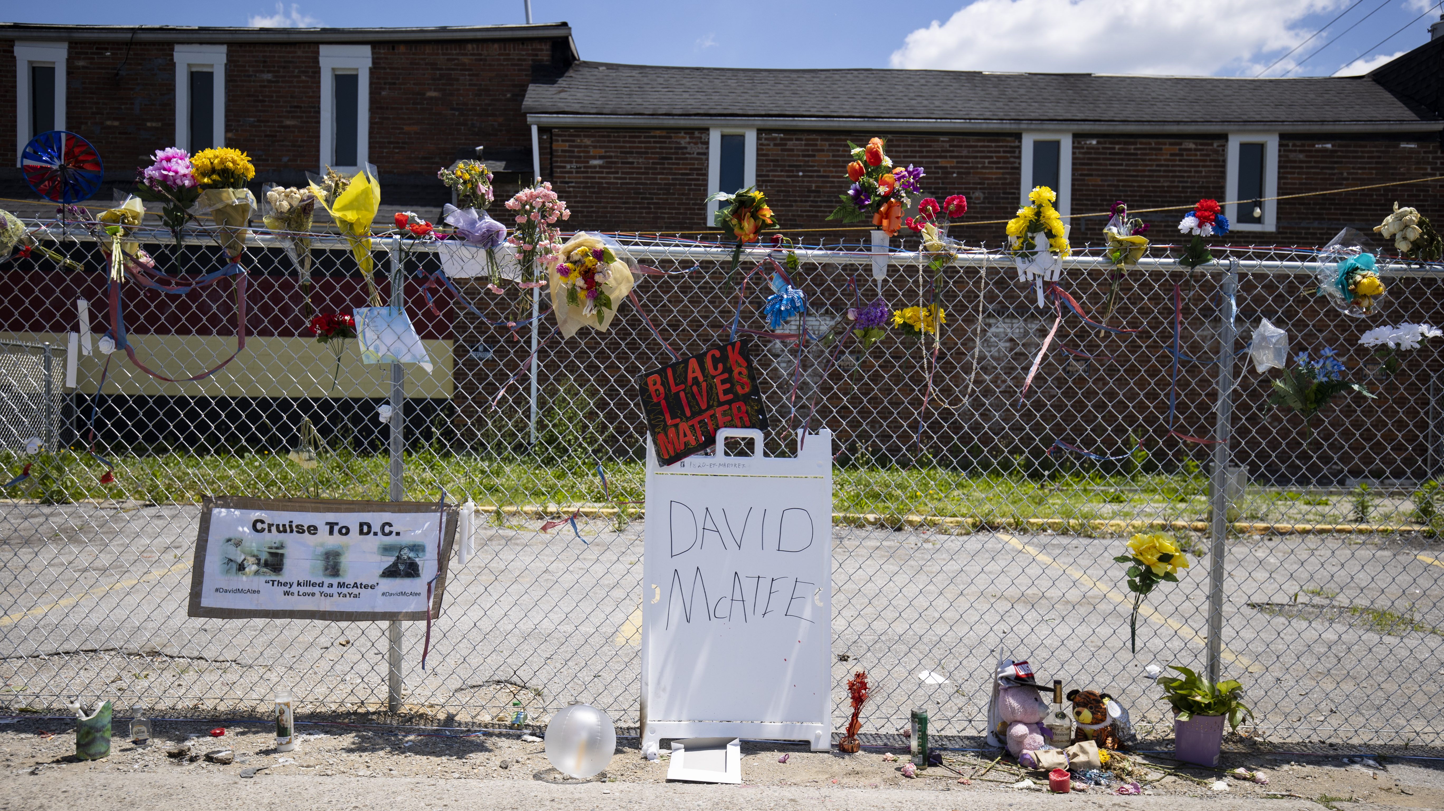 A memorial for David McAtee outside the location where he was shot and killed