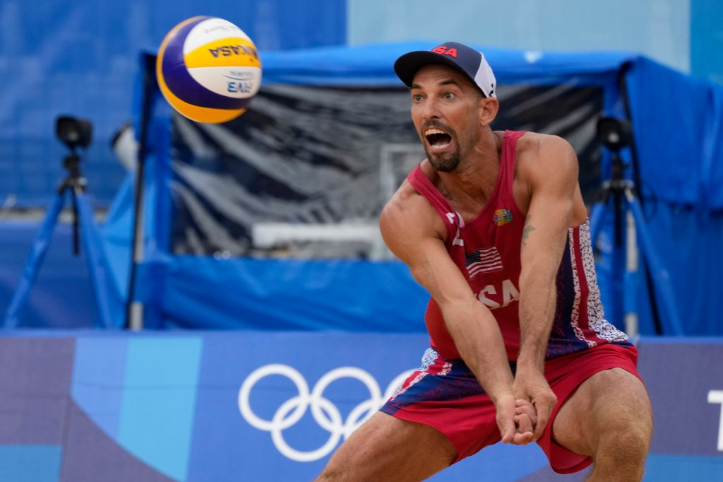 Nicholas Lucena, of the United States, returns a shot during a men's beach volleyball match against Brazil at the 2020 Summer Olympics, Tuesday, July 27, 2021, in Tokyo, Japan.