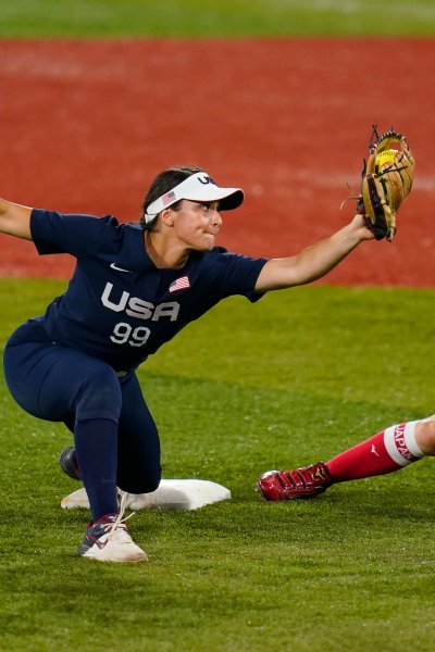 Japan's Mana Atsumi, right, is forced out by United States' Delaney Spaulding during a softball game at the 2020 Summer Olympics