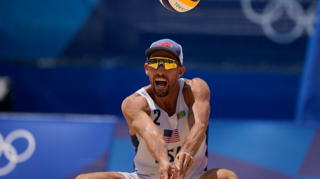 Nicholas Lucena, of the United States, competes during a men's beach volleyball match
