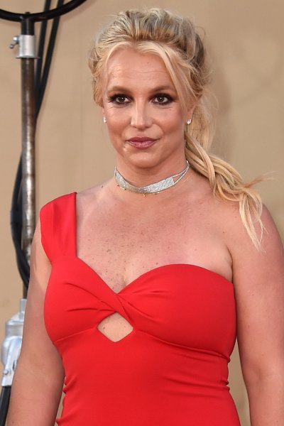 """FILE - Britney Spears arrives at the Los Angeles premiere of """"Once Upon a Time in Hollywood"""" on July 22, 2019. When Spears speaks to a judge at her own request on Wednesday, June. 23, 2021, she'll do it 13 years into a court-enforced conservatorship that has exercised vast control of her life and money by her father. Spears has said the conservatorship saved her from collapse and exploitation. But she has sought more control over how it operates, and says she wants her father out."""
