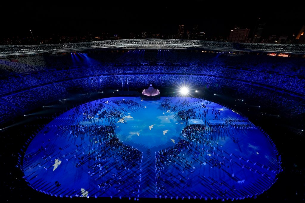 Doves are projected on the field during the opening ceremony at the Olympic Stadium at the 2020 Summer Olympics, Friday, July 23, 2021, in Tokyo.