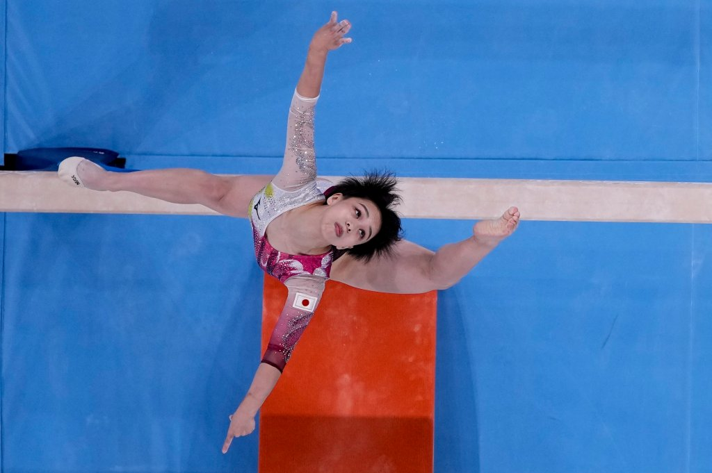 Mai Murakami, of Japan, performs on the beam during women's artistic gymnastic qualifications at the 2020 Olympics on July 25, 2021, in Tokyo.