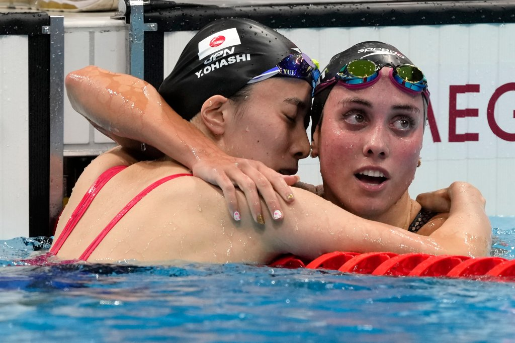 Yui Ohashi, of Japan, left, is embraced by Emma Weyant, of United States, after winning the final of the women's 400-meter Individual medley at the 2020 Summer Olympics, Sunday, July 25, 2021, in Tokyo, Japan.