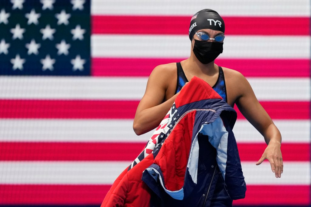 Torri Huske of the United States walks to the starting blocks for her race in the final of the women's 100-meter butterfly at the 2020 Summer Olympics, Monday, July 26, 2021, in Tokyo, Japan.