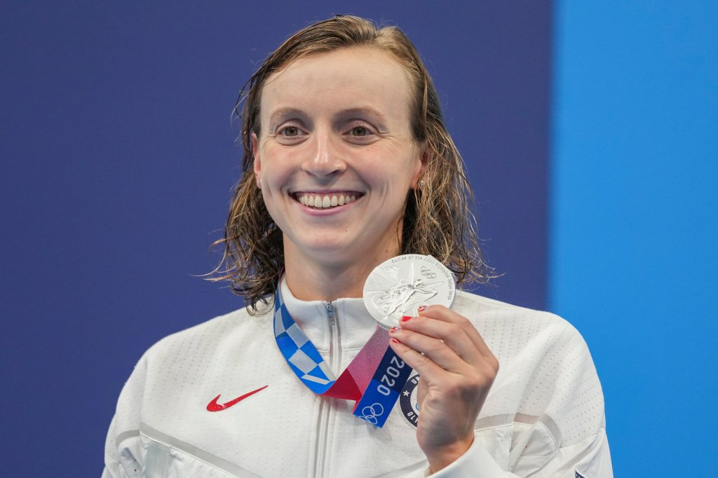 Katie Ledecky, of the United States poses with her silver medal in the women's 400-meters freestyle at the 2020 Olympics on July 26, 2021, in Tokyo, Japan.