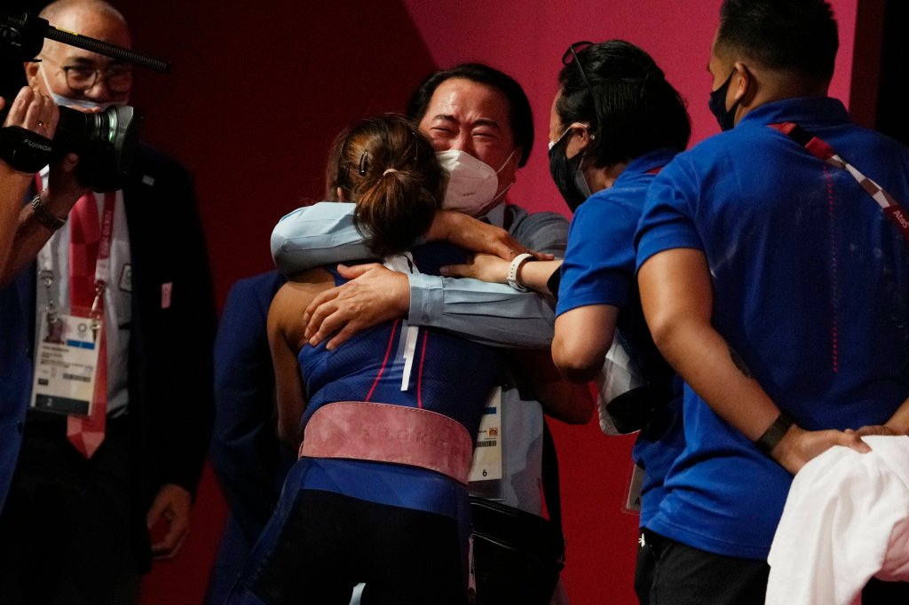 Hidilyn Diaz of Philippines celebrates with Weightlifting Philippines federation president Monico Puntuevella after winning the gold medal in the women's 55kg weightlifting event, at the 2020 Summer Olympics on July 26, 2021, in Tokyo, Japan.