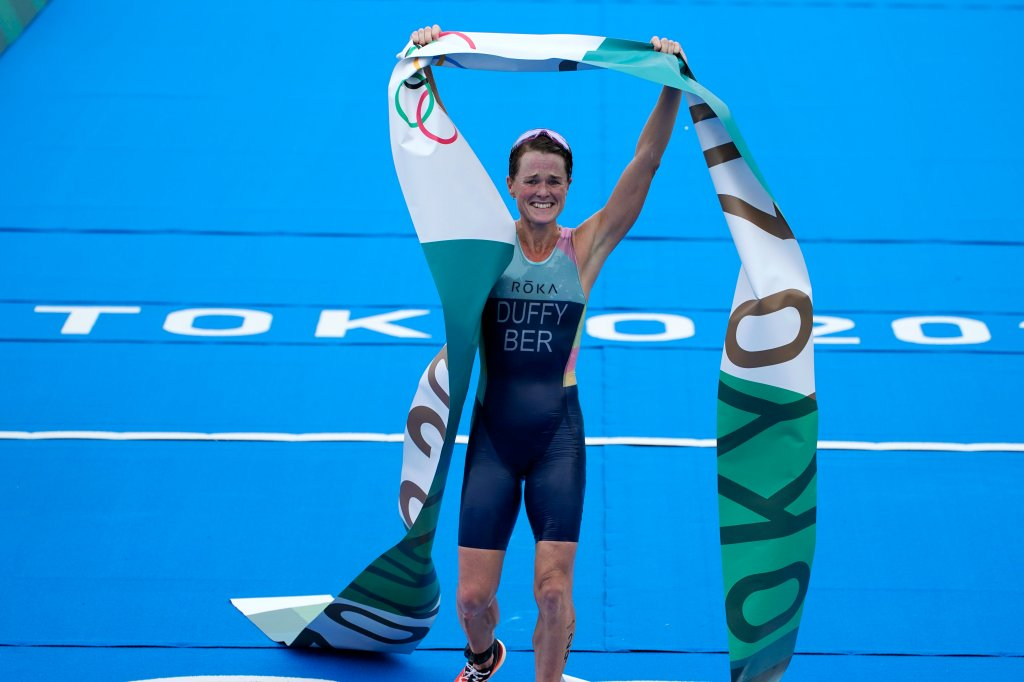 Flora Duffy of Bermuda celebrates after crossing the finish line to win the gold medal in the women's individual triathlon competition at the 2020 Olympics on July 27, 2021, in Tokyo, Japan.