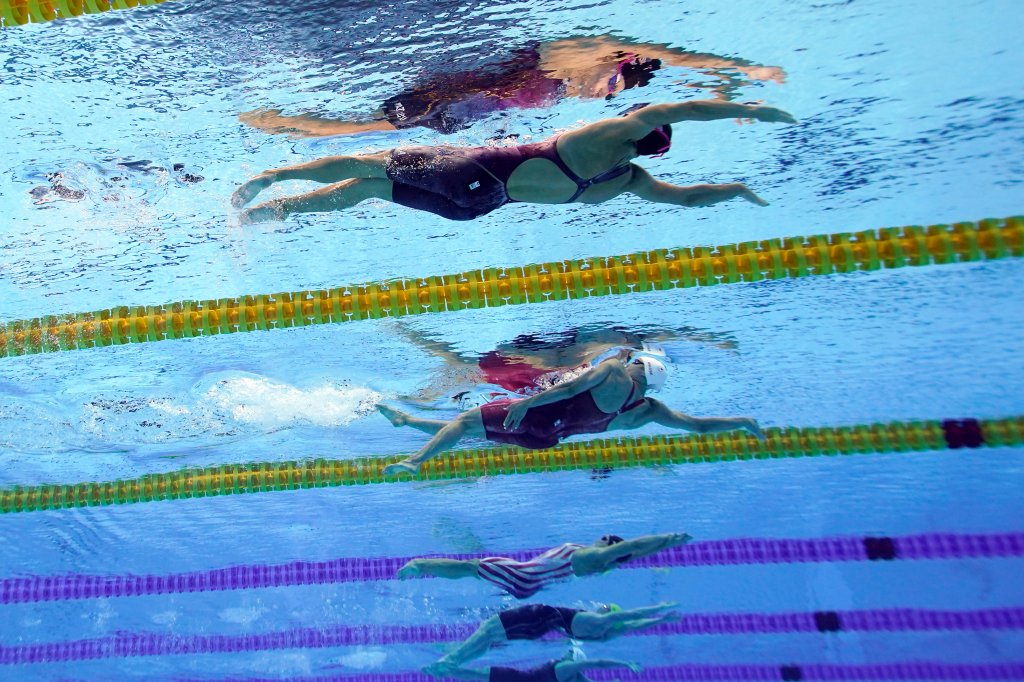 United States' Regan Smith, top, swims to win the bronze medal in the 100-meter backstroke final at the 2020 Olympics on July 27, 2021, in Tokyo.